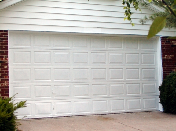 Garage door panel repair advanced door garage doors ogden utah garage door repair ogden utah solutioingenieria Choice Image